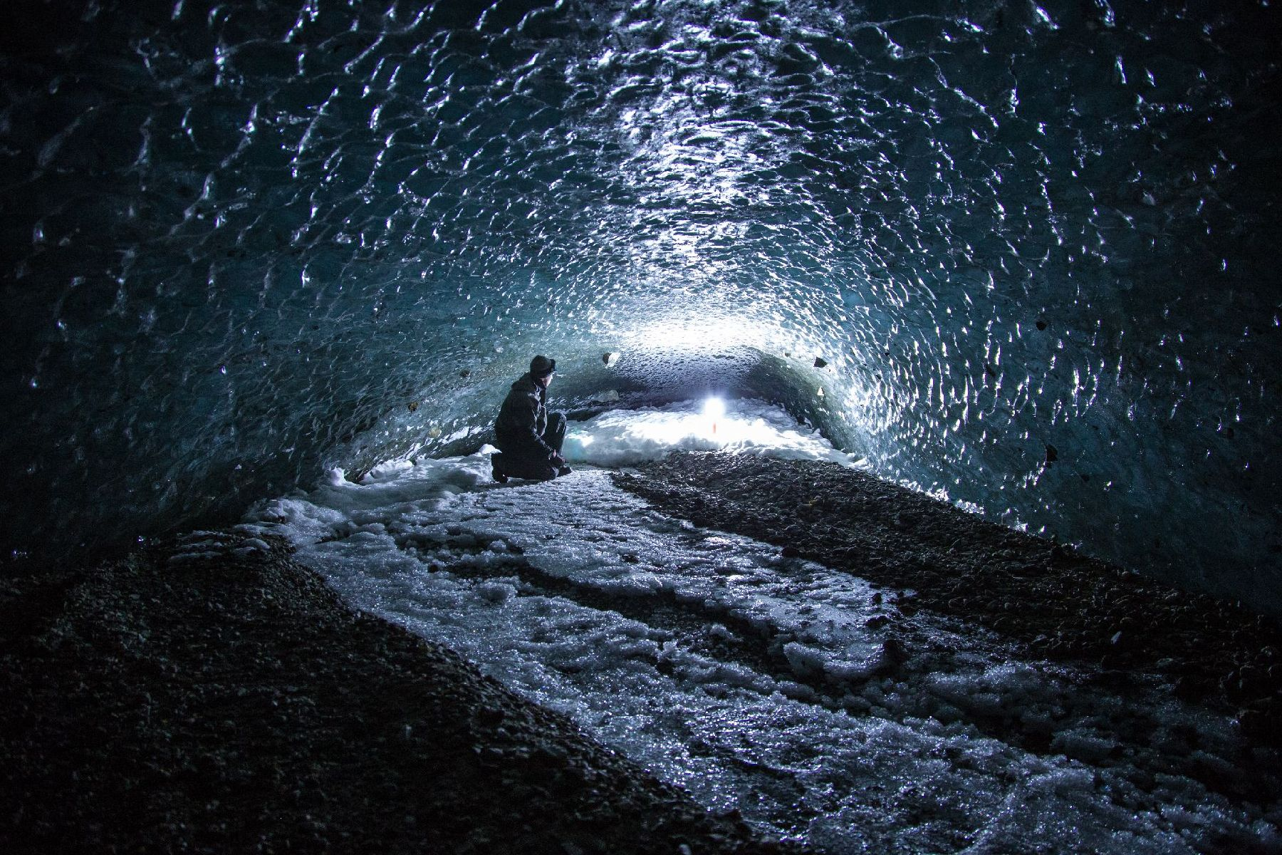 My lantern provides the only light at the end of this ice tunnel underneath Canwell Glacier.  The en
