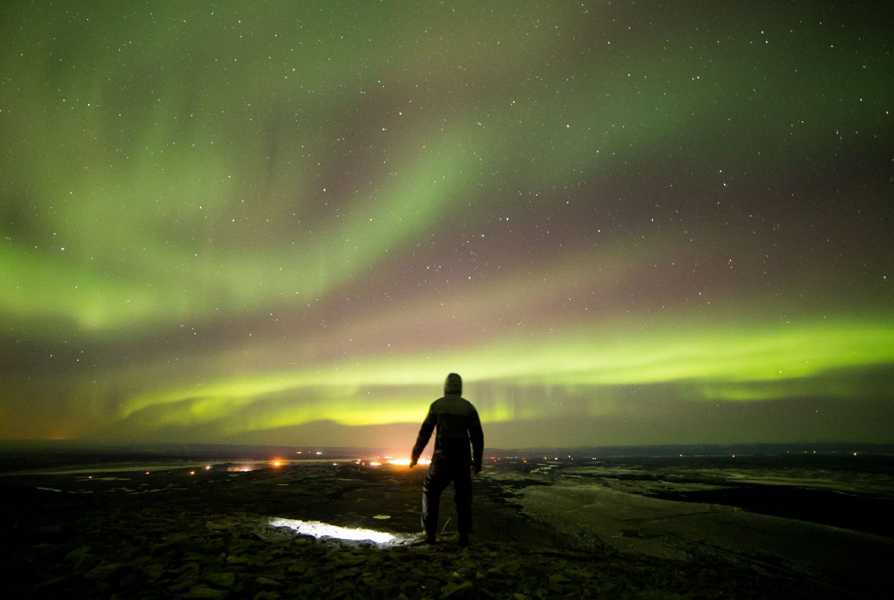 I climbed Donnelly Dome on a windy November night to photograph the aurora over Fort Greely and Delt