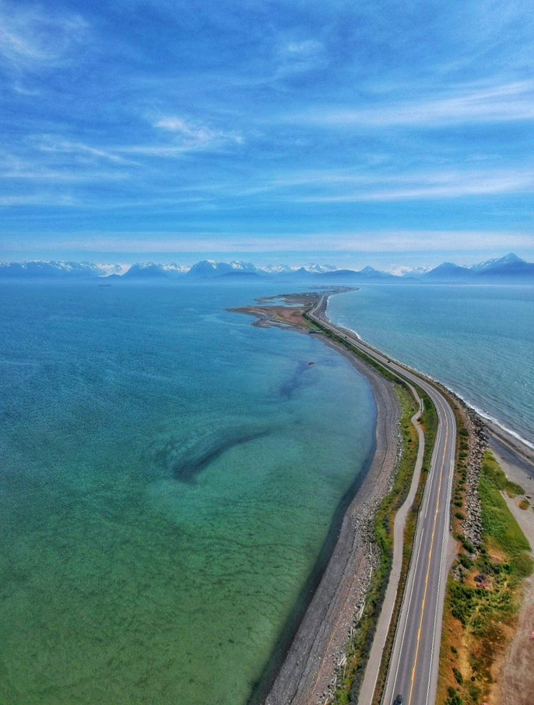 Home spit stretches into blue waters of Kachemak Bay
