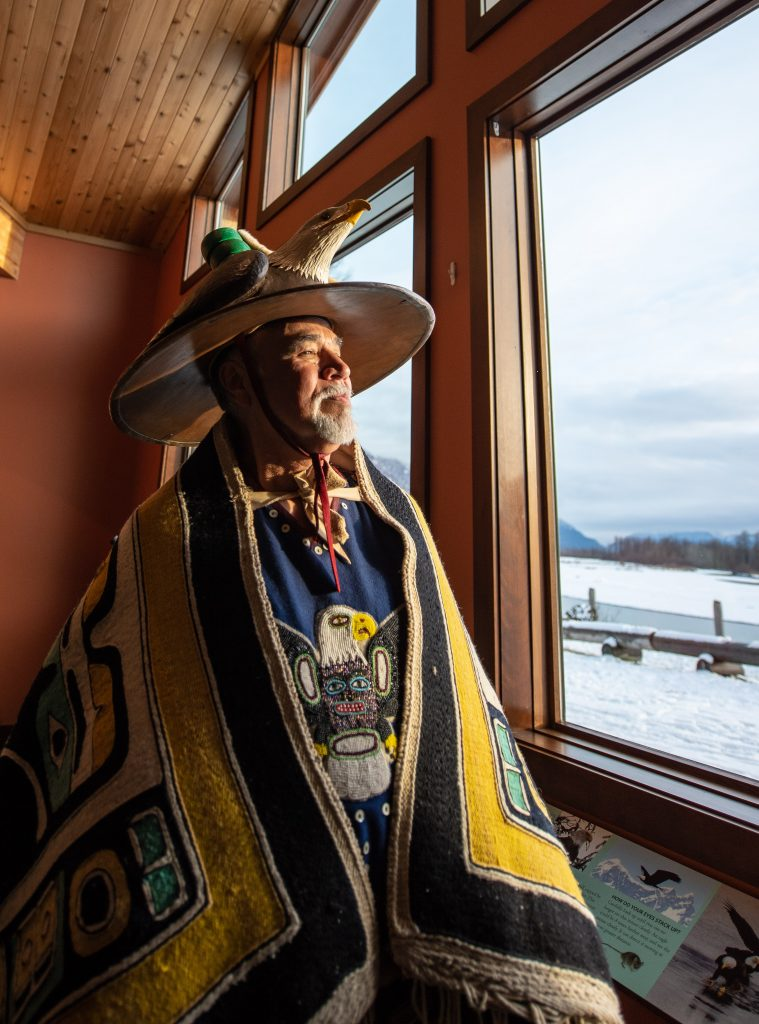 An Alaska Native from the Wolf House in Klukwan wears traditional Tlingit garb
