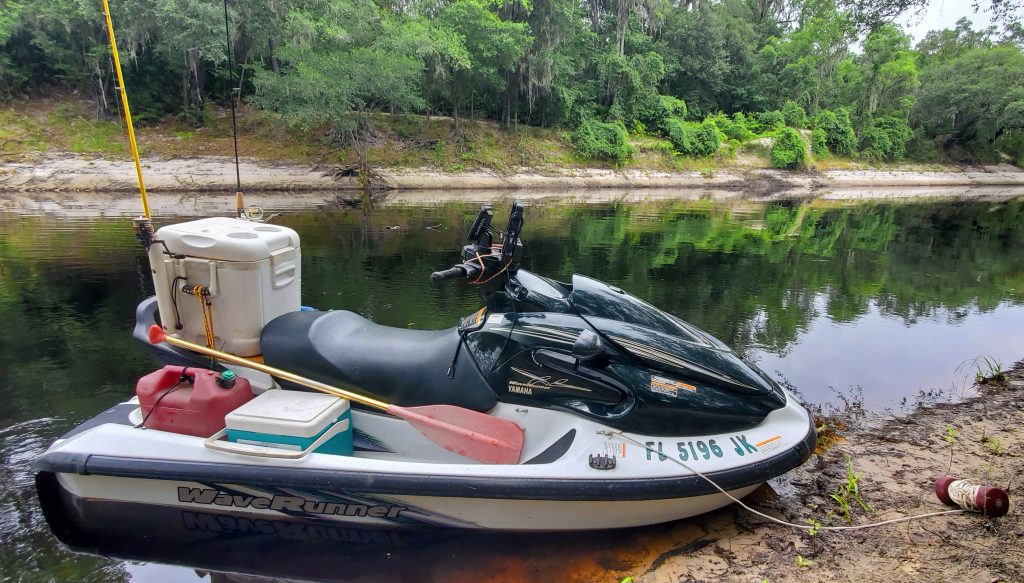 Nick Jan's jetski on the banks of the Suwannee River