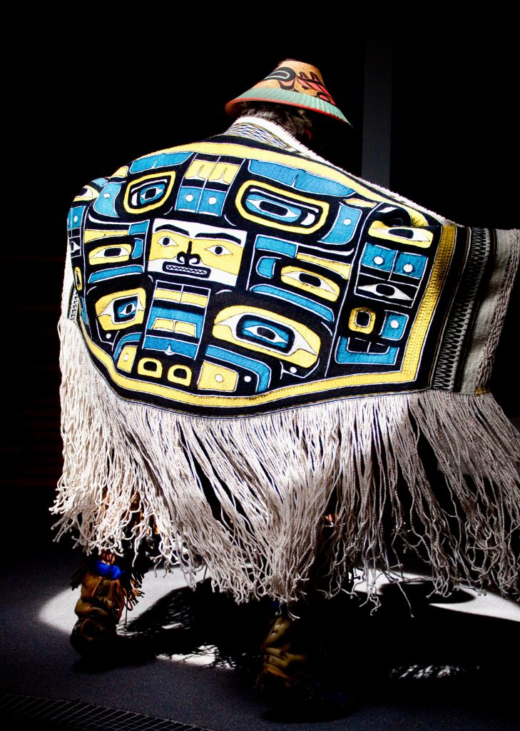 Blue and yellow robe with white fringe