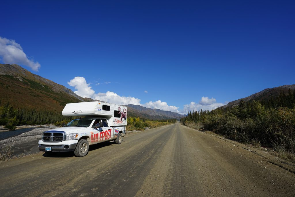 Milepost truck with cab-over camper on Dalton Highway