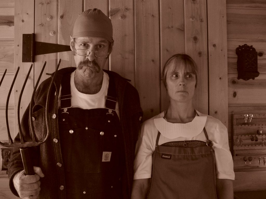 Steve Kahn and his wife dressed up like American Gothic painting