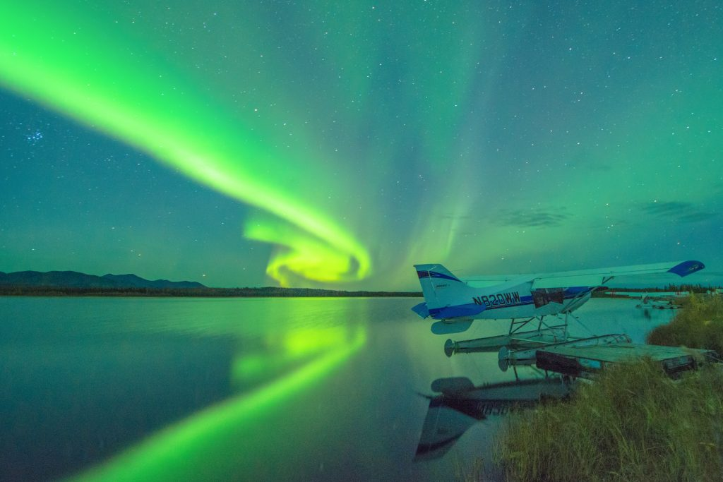 northern lights and the a moored float plane