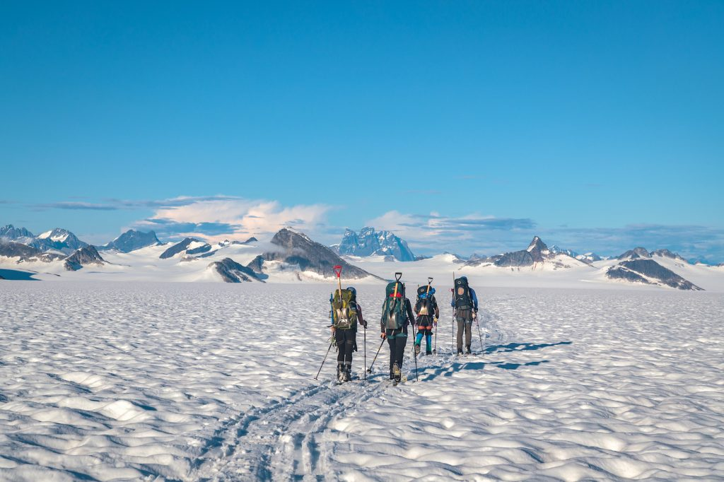 Students walk across snow-covered ice field