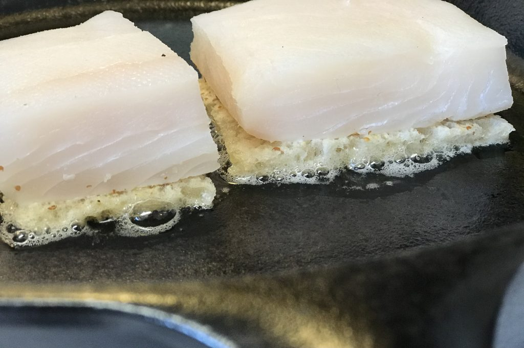 Halibut cooking over sourdough