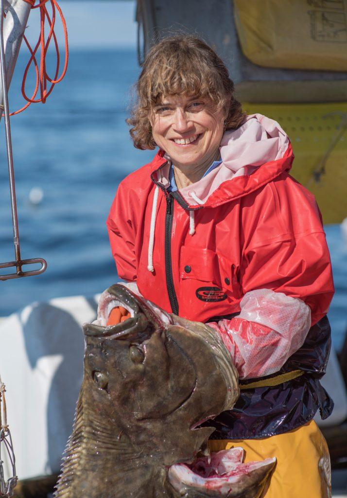 Linda Behnken holding a fish she caught