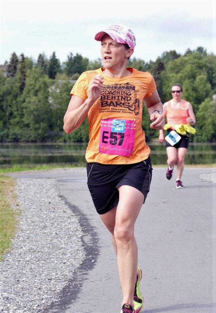 Lisa Keller running along trail