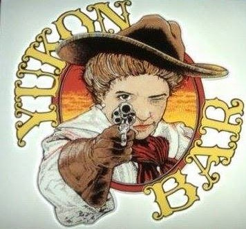 Yukon Bar logo of a woman in a hat pointing a six-shooter at the viewers