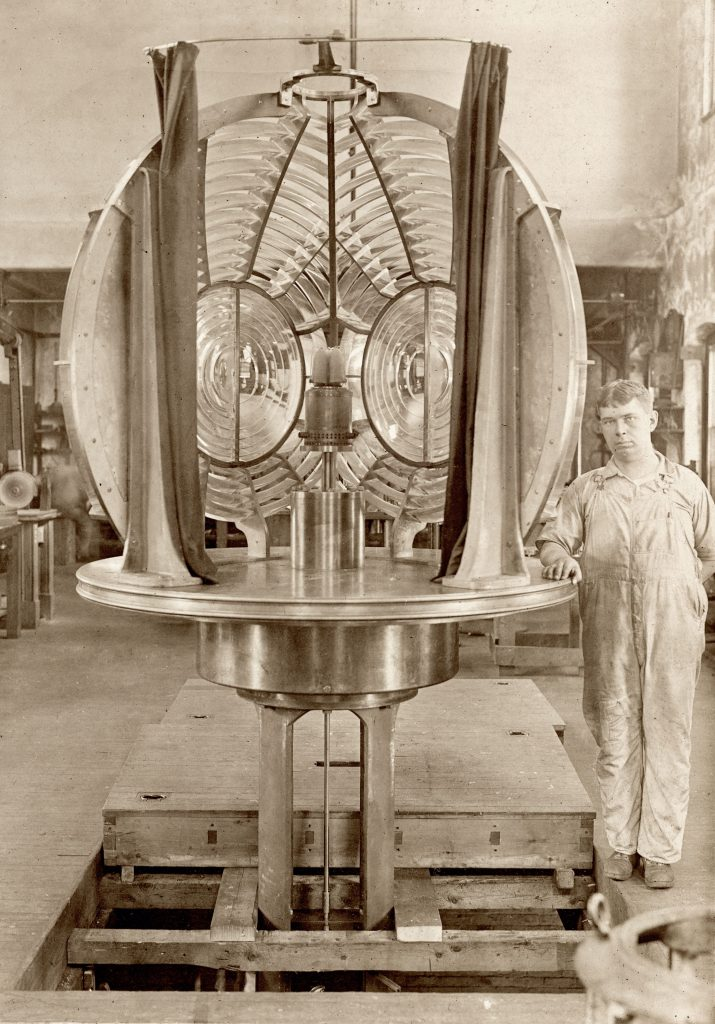 Sepia photo of electric lighthouse lens