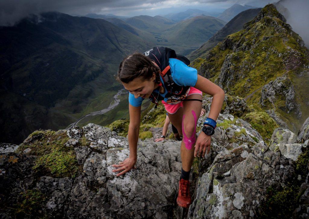 Ann Spencer climbing a mountain