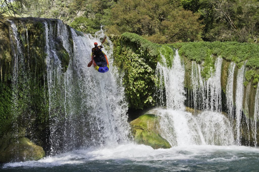 Luc Mehl dropping over a waterfall