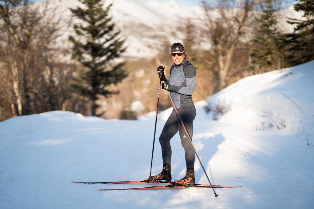 Rosie Brennan posing on cross country skis in winter