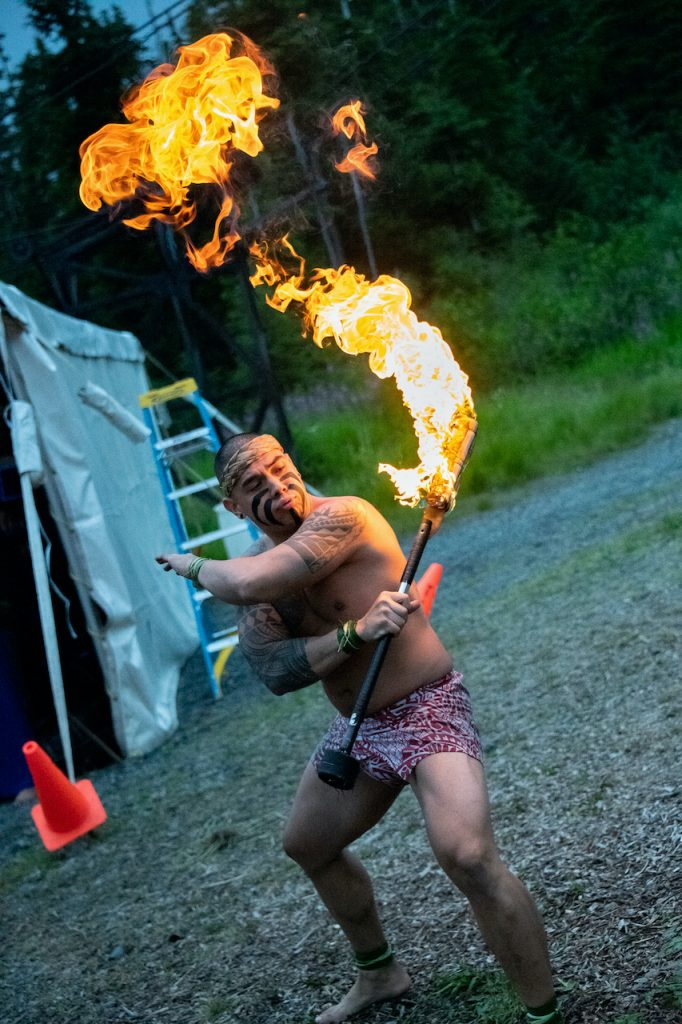 Hawaiian man dancing with fire in Alaska