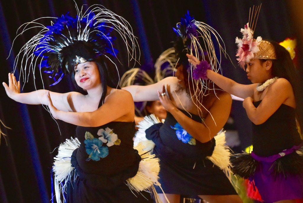 Women in Polynesian dress dancing