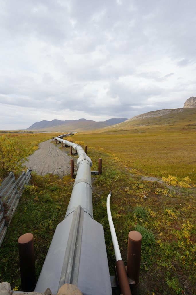 Image of Trans Alaska pipeline front directly above, as pipeline wends into the distance