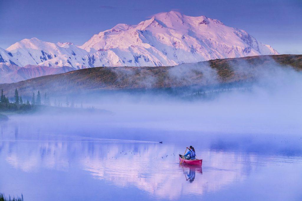 Canoe on Wonder Lake with morning fog and Denali in background